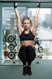 Woman Performing Hanging Leg Raises Exercise Royalty Free Stock Photo