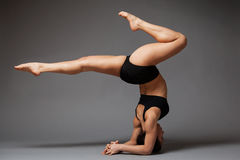 Woman performing headstand Stock Photos