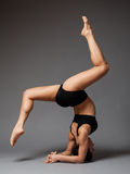 Woman performing headstand Royalty Free Stock Photo