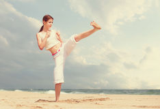 Woman performing a kick Royalty Free Stock Photography