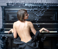Woman performing music on piano stock photos