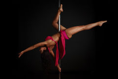 Woman performing pole dance Royalty Free Stock Photos