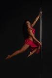Woman performing pole dance Stock Photos