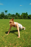 Woman performing push-up Stock Image