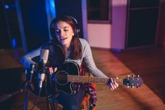 Woman performing in a recording studio royalty free stock photos