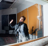 Woman Performing In Recording Studio Seen Through royalty free stock photos