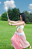 Woman performing with a sword Stock Image