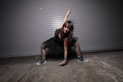Woman performing an urban dance Stock Photos