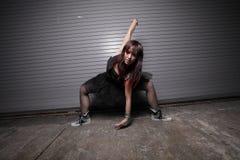 Woman performing an urban dance Stock Photos