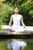 Woman performing yoga Stock Photography