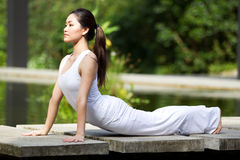Woman performing yoga Stock Image