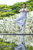 Woman performing yoga Stock Photo