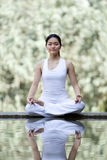 Woman performing yoga Stock Images