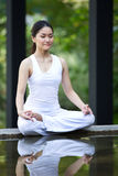 Woman performing yoga Royalty Free Stock Image