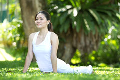 Woman performing yoga Royalty Free Stock Photography