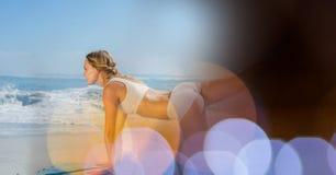 Woman performing yoga at beach Royalty Free Stock Photos
