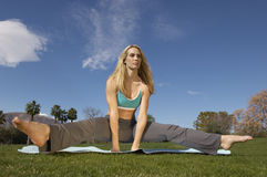 Woman Performing Yoga On Mat Stock Photography