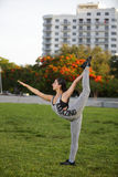 Woman performing yoga in the park Stock Photos
