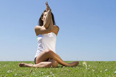Woman performing Yoga Royalty Free Stock Photo