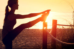 Woman performs exercises Stock Images