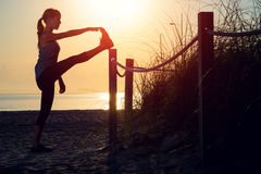 Woman performs exercises Royalty Free Stock Photo