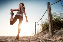 Woman performs exercises Stock Photos