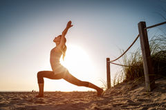 Woman performs exercises Stock Photography