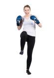 Woman performs kick Royalty Free Stock Photos