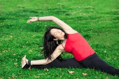 Woman Performs Side Bend In Park Stock Images