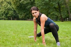 Woman performs stretching Stock Photo