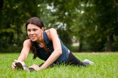 Woman performs stretching Royalty Free Stock Photos