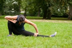 Woman performs stretching before Royalty Free Stock Photos