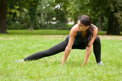 Woman performs stretching before Stock Photography
