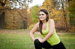 Woman performs stretching before jogging stock images