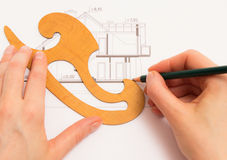 Woman performs technical drawing Stock Photo