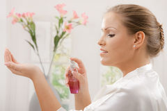 Woman with perfume Stock Image
