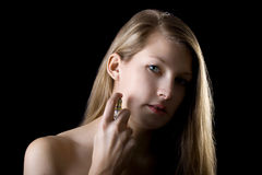 Woman with perfume Stock Images