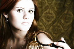 Woman with Perfume Atomizer. Beautiful young woman with perfume atomizer royalty free stock images