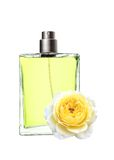 Woman perfume in beautiful bottle and yellow rose flower Royalty Free Stock Photo