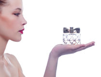 Woman with perfume bottle Royalty Free Stock Photography