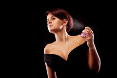 Woman and perfume Royalty Free Stock Photography