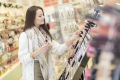 Woman in perfumery. Young woman in the perfumery Stock Photos