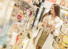 Woman in the perfumery. Young woman in the perfumery Stock Image