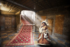 Woman in period costume in nineteenth-century apartment Royalty Free Stock Image
