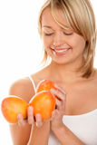 Woman with persimmons Stock Images