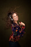 Woman with personal listening device Royalty Free Stock Photography