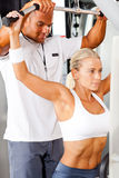 Woman and personal trainer Stock Photos