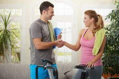 Woman with personal trainer. Young women shaking hands with her personal trainer after training Royalty Free Stock Photography