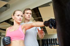 Woman with personal trainer boxing in gym Royalty Free Stock Photo