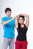 Woman with personal trainer Royalty Free Stock Image